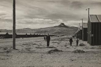 Internees roam the desolate Heart Mountain Relocation Center near Cody, Wyoming, in 1942.