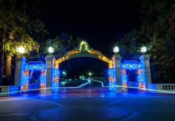 Sather Gate lit up at night