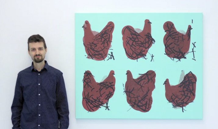 Tom next to pictures of Chickens