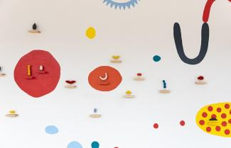 A wall with small, colorful objects on the wall