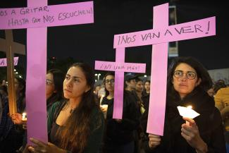 Demonstrators protest feminicide and violence against women on the International Day for the Elimination of Violence against Women in Mexico City, Mexico, on Nov. 25, 2019. UC Berkeley graduate student Laila Espinoza says these magenta crosses, planted all over the city of Ciudad Juárez and across the country, are powerful and enduring symbols of resistance and a way to reclaim public space and make the ongoing feminicides visible, when the government refuses to do so.